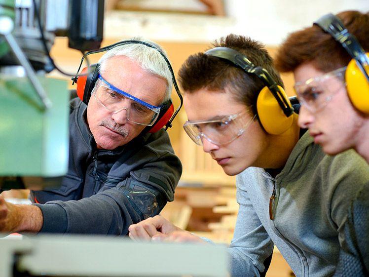 OTC staff member training students