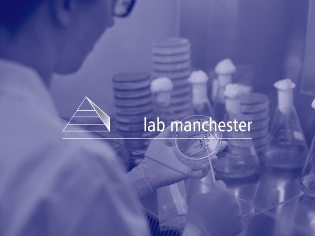 Lab technician cleaning petri dish